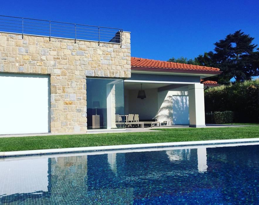Fabbricato residenziale unifamiliare: Case in stile In stile Country di Fabrizio Alborno Studio di Architettura ALBORNO\GRILZ