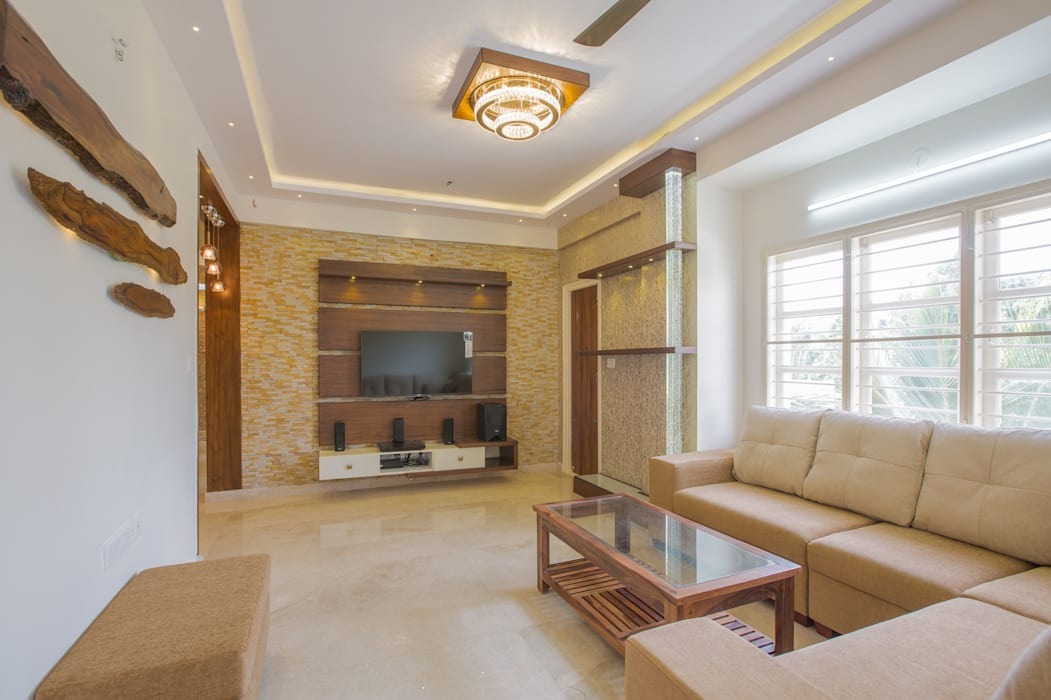 3 BHK apartment interiors in rustic look theme :  Living room by In Built Concepts