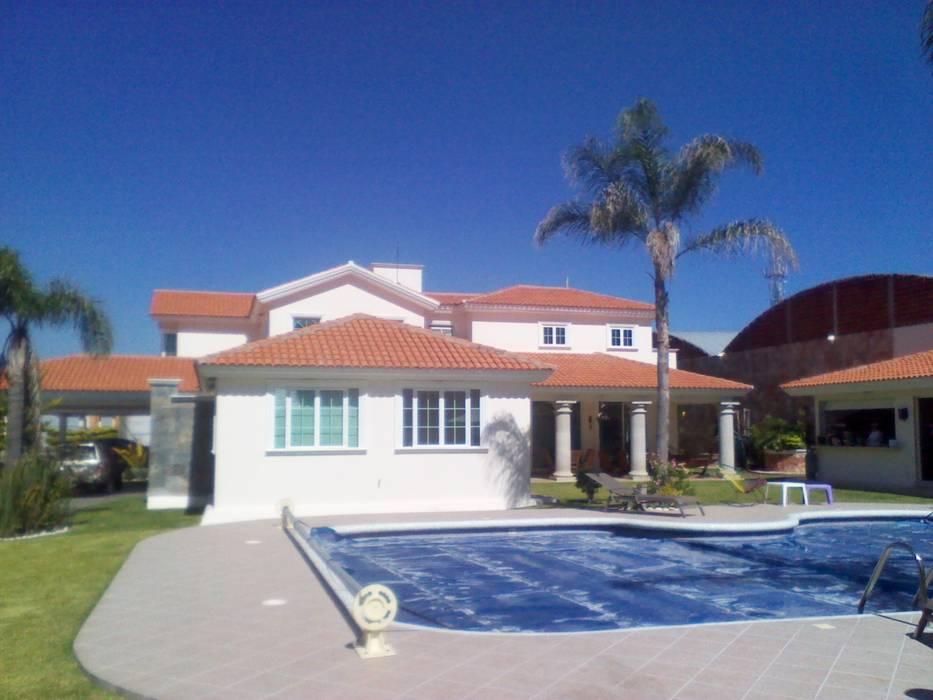 CASA F8: Albercas de estilo clásico por SG Huerta Arquitecto Cancun