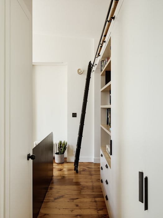 Living Room with Library:  Living room by General Assembly