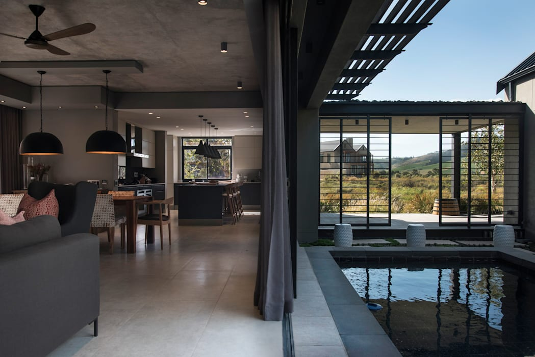 Threshold between Interior Living & Outdoor Pool Area Country style windows & doors by Tim Ziehl Architects Country