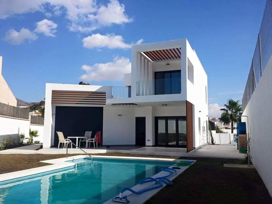 Vivienda Unifamiliar, Garaje y piscina Casas de estilo moderno de SPArquitectos Moderno