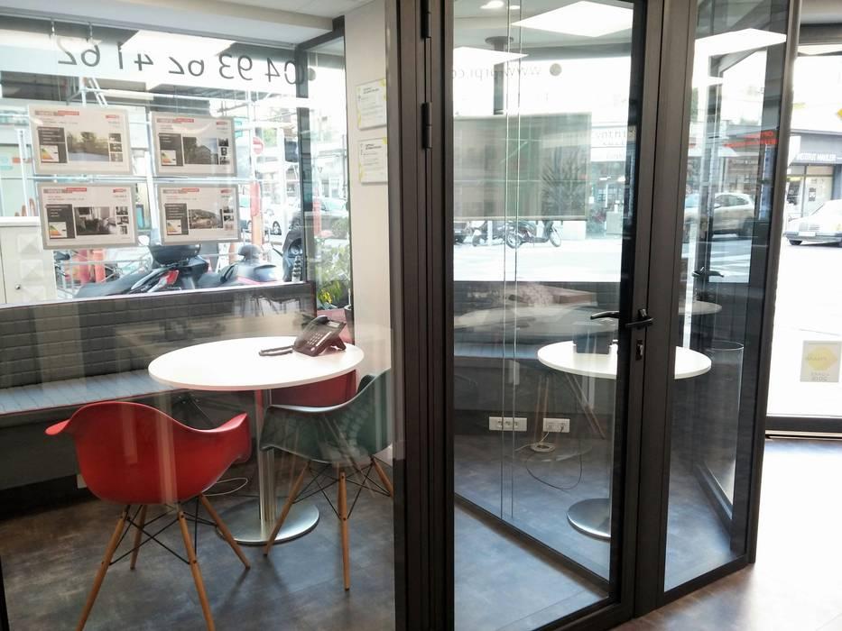 Bureau individuel: Espaces commerciaux de style  par Casavog