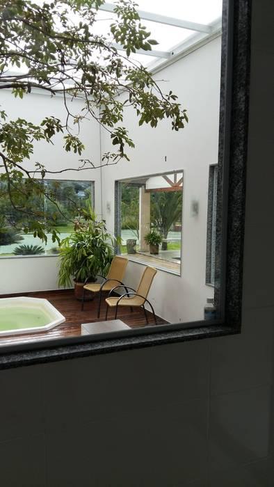Spa na serra. Ana Adriano Design de Interiores Spa eclético
