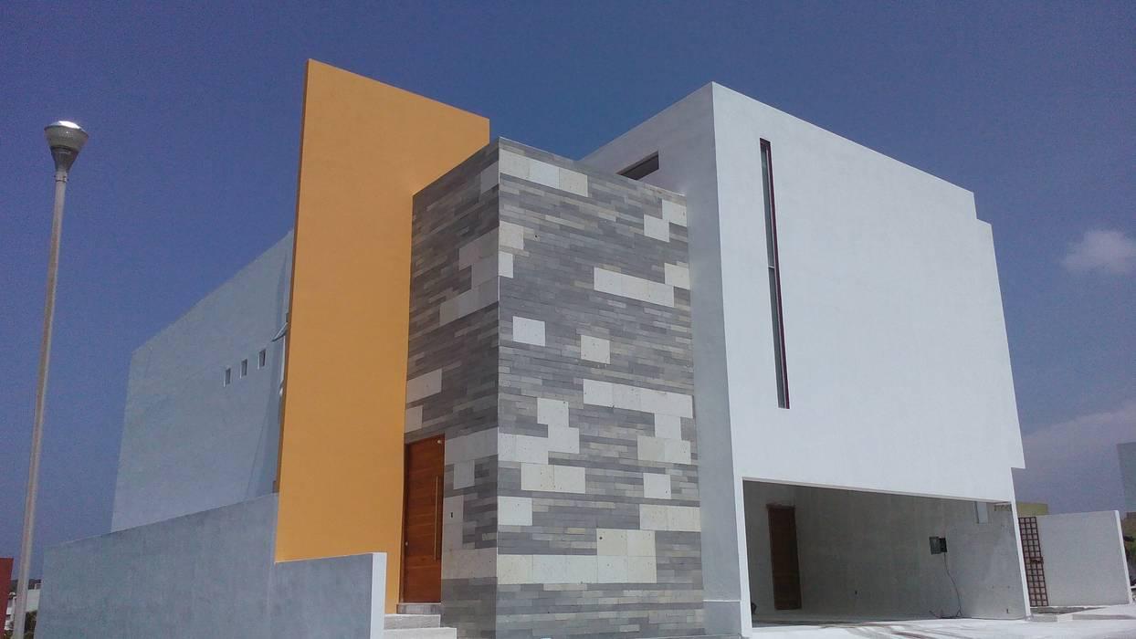 Casa Bjork: Casas de estilo moderno por escala1.4