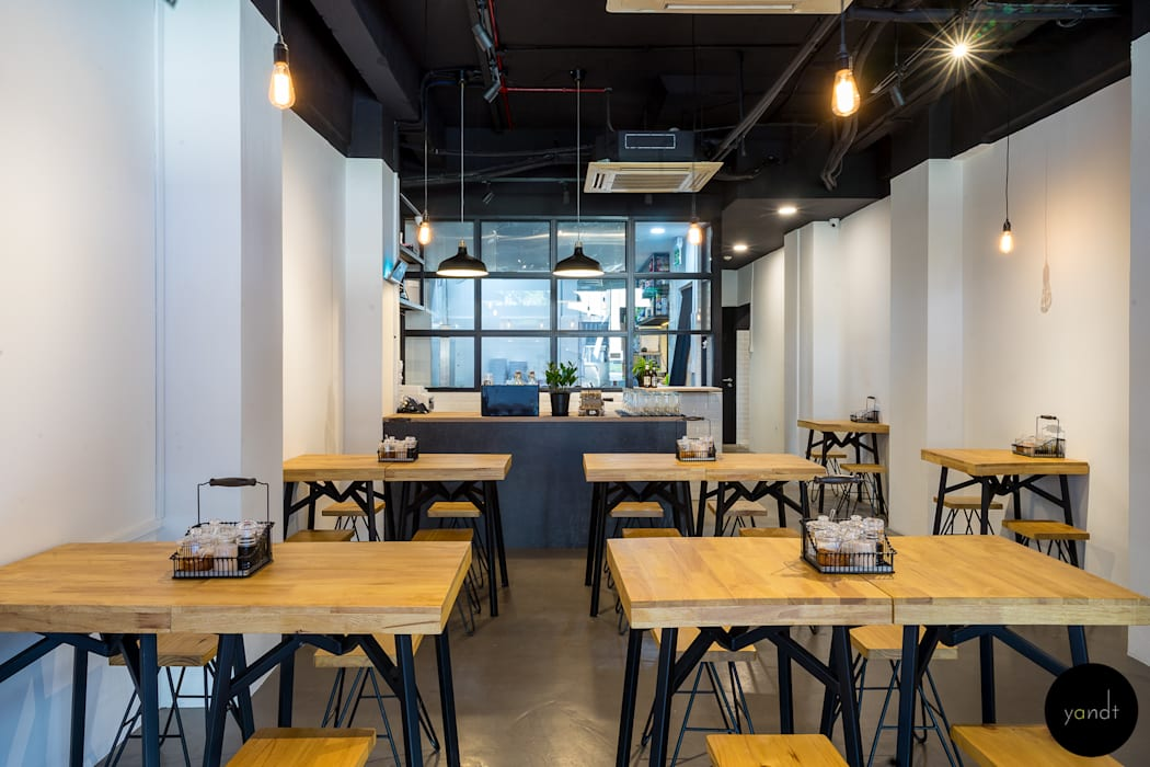 Main seating area Rustic style gastronomy by Y&T Pte Ltd Rustic