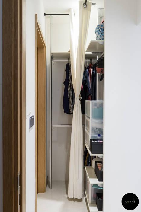 Extra wardrobe space Scandinavian style dressing room by Y&T Pte Ltd Scandinavian