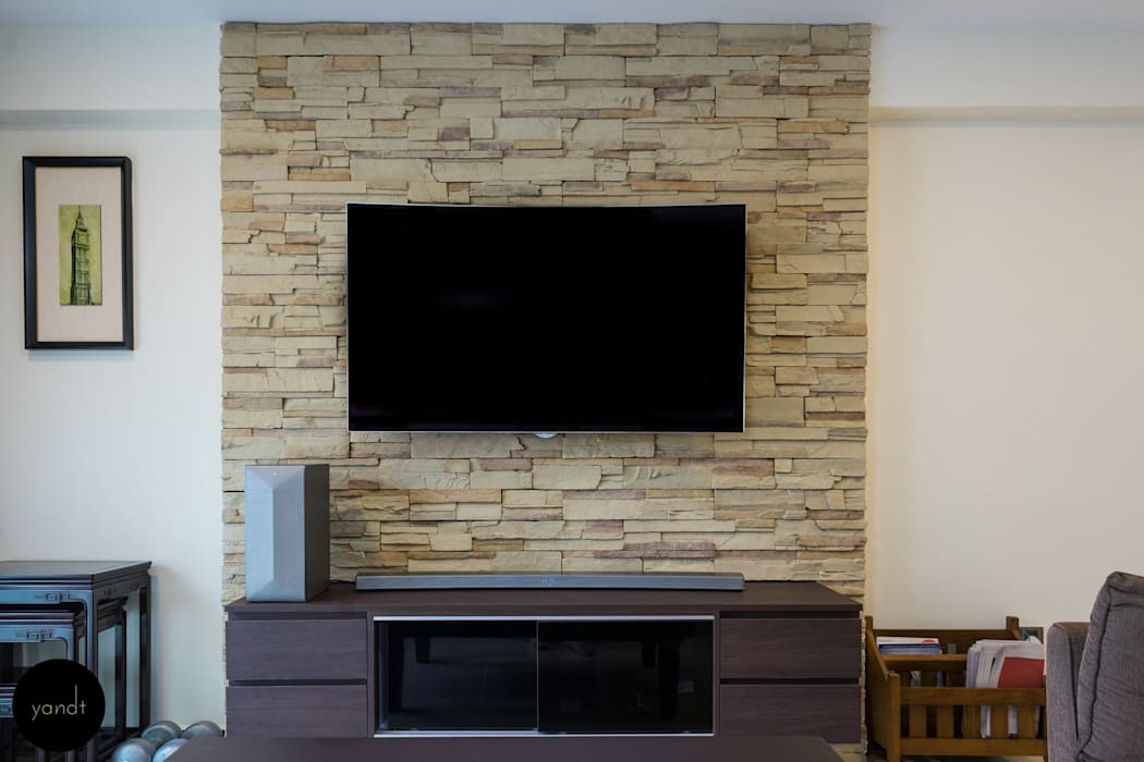 TV console and feature wall:  Living room by Y&T Pte Ltd