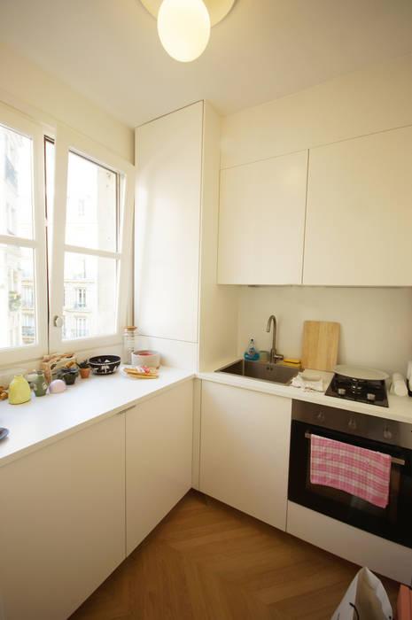 Rénovation appartement Paris, quartier Montmartre: Cuisine de style  par Grazia Architecture