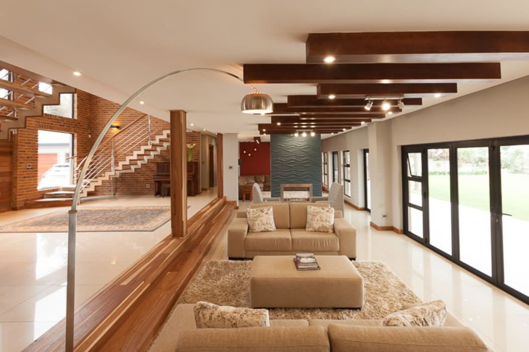 Living room by Redesign Interiors, Modern