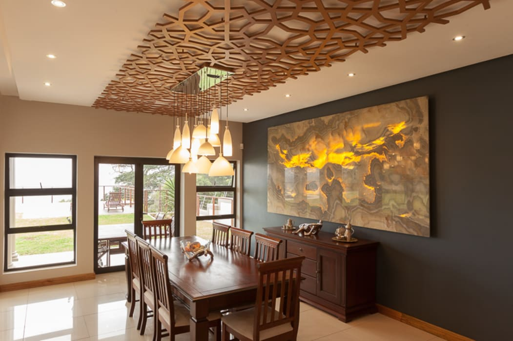 Dining room by Redesign Interiors, Modern