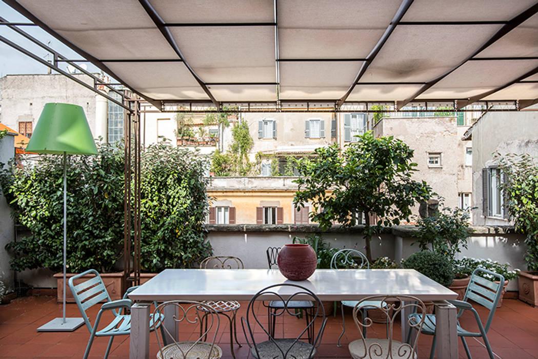 Balcones y terrazas eclécticos de studioQ Ecléctico