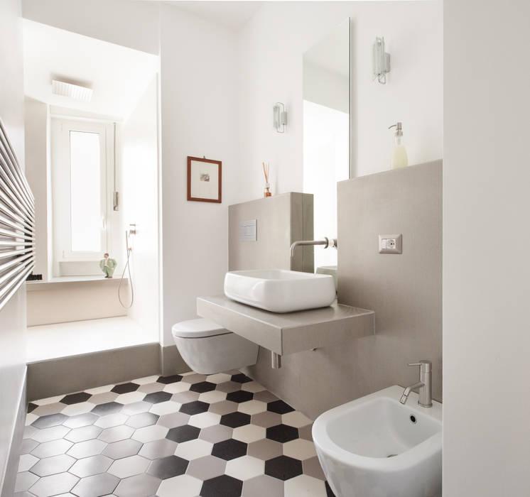 Baños de estilo moderno de studioQ Moderno