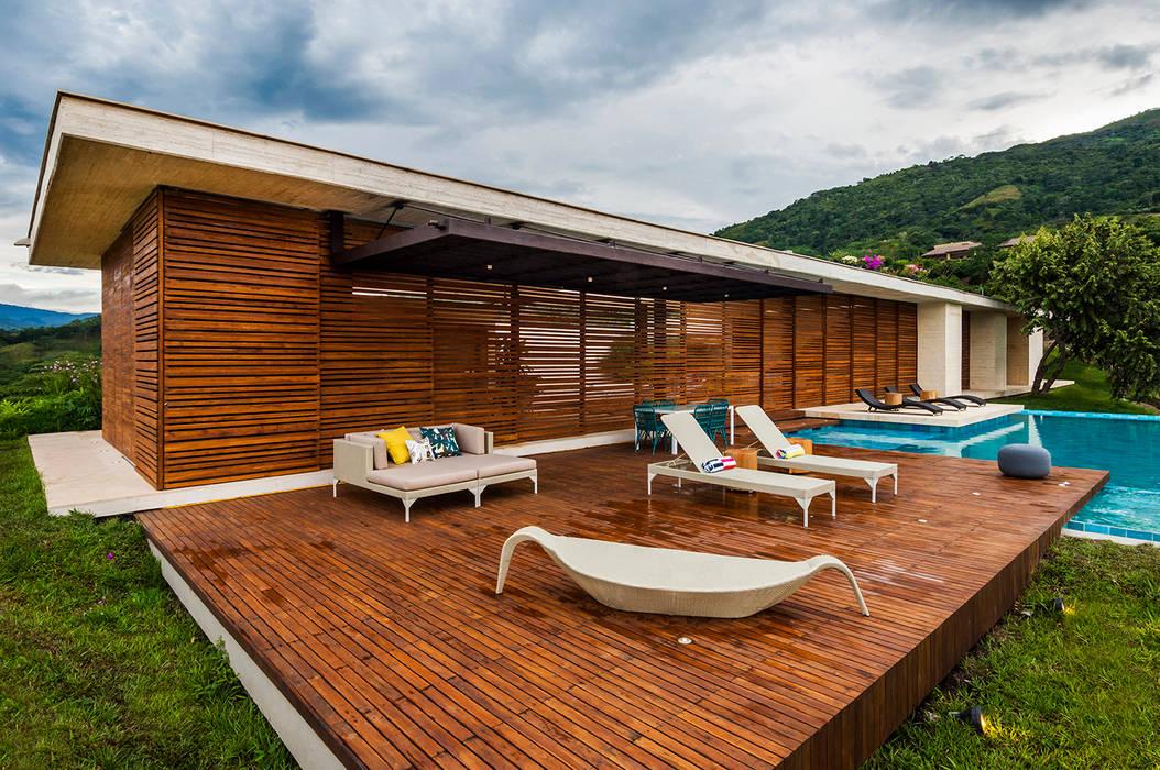 Houses by Arquitectura en Estudio, Modern Wood Wood effect
