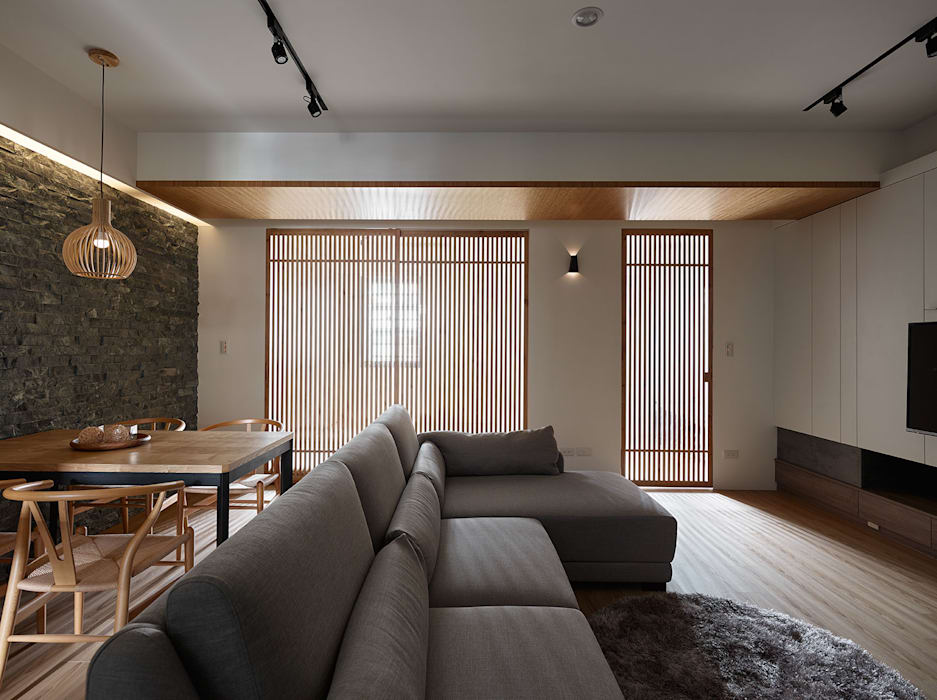 Salon de style  par 大集國際室內裝修設計工程有限公司