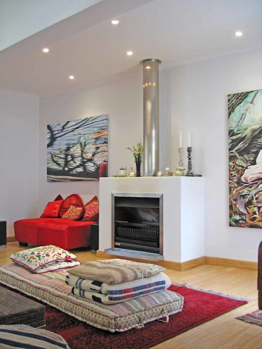 fire place:  Living room by Till Manecke:Architect