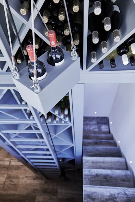 View down the wine rack:  Wine cellar by Adventure In Architecture