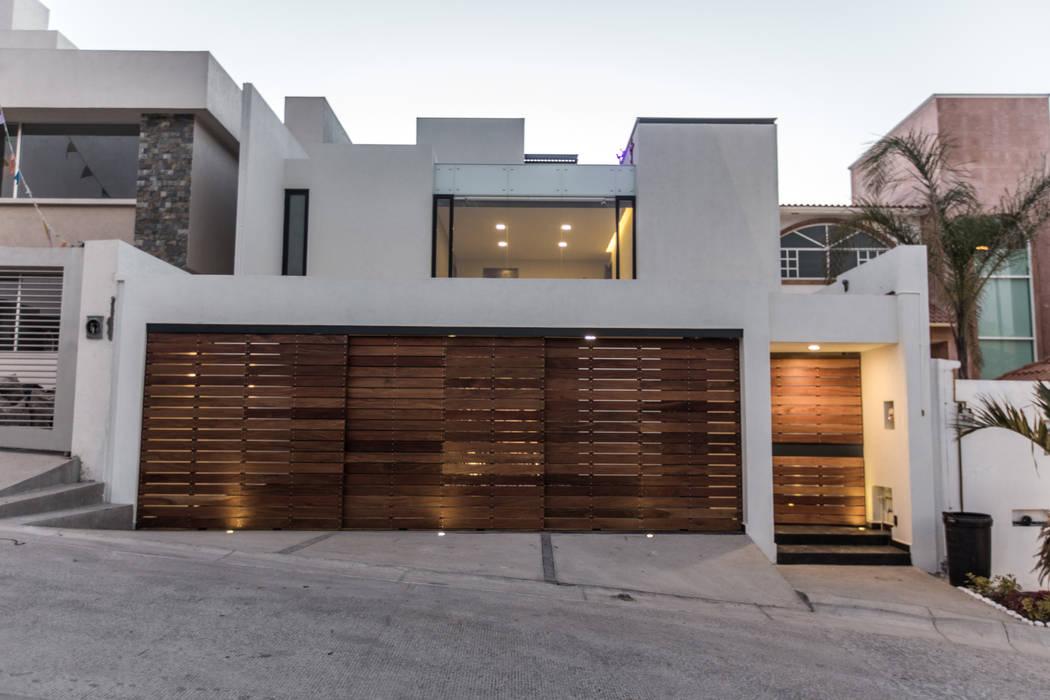 3. CASA TARE: Oficinas y tiendas de estilo  por TARE arquitectos