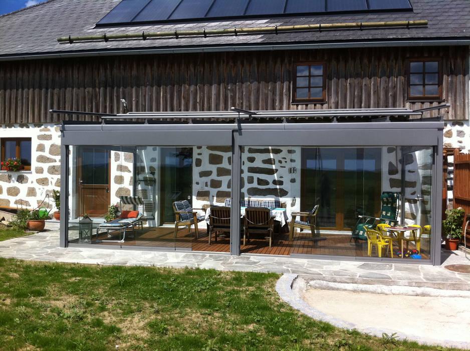 Schmidinger Wintergärten, Fenster & Verglasungen Nhà kính phong cách kinh điển Nhôm / Kẽm Grey