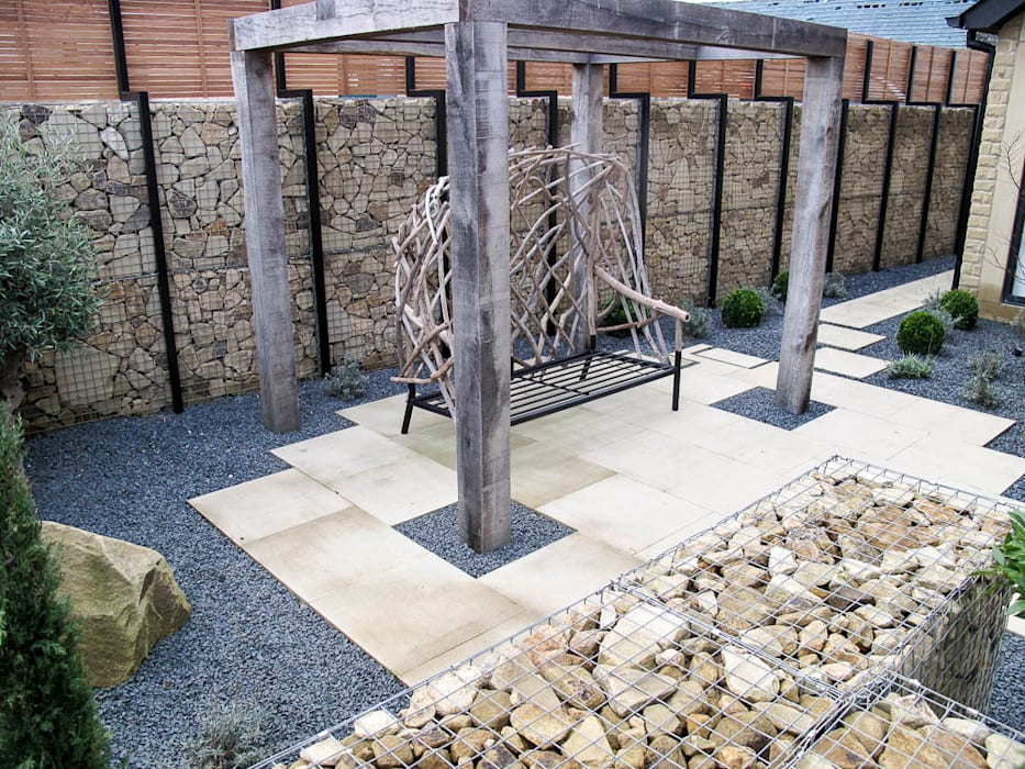 New wooden canopy and woven seat:  Garden by Yorkshire Gardens