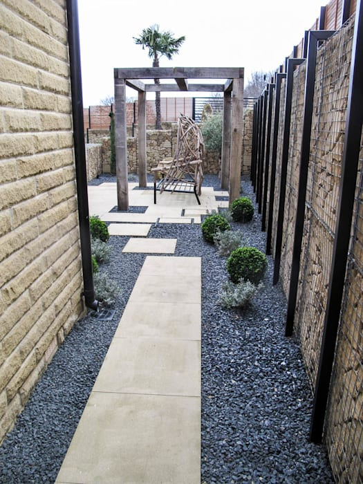 Gabion and paved pathway:  Garden by Yorkshire Gardens