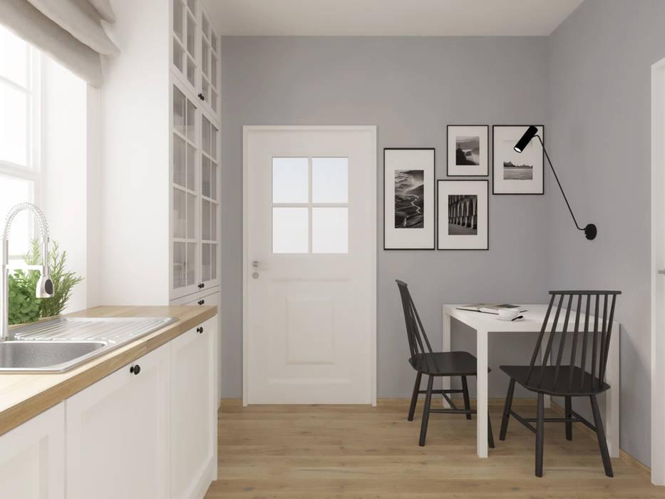 Biała kuchnia z drewnianym blatem SO INTERIORS ARCHITEKTURA WNĘTRZ Rustykalna kuchnia Drewno Biały