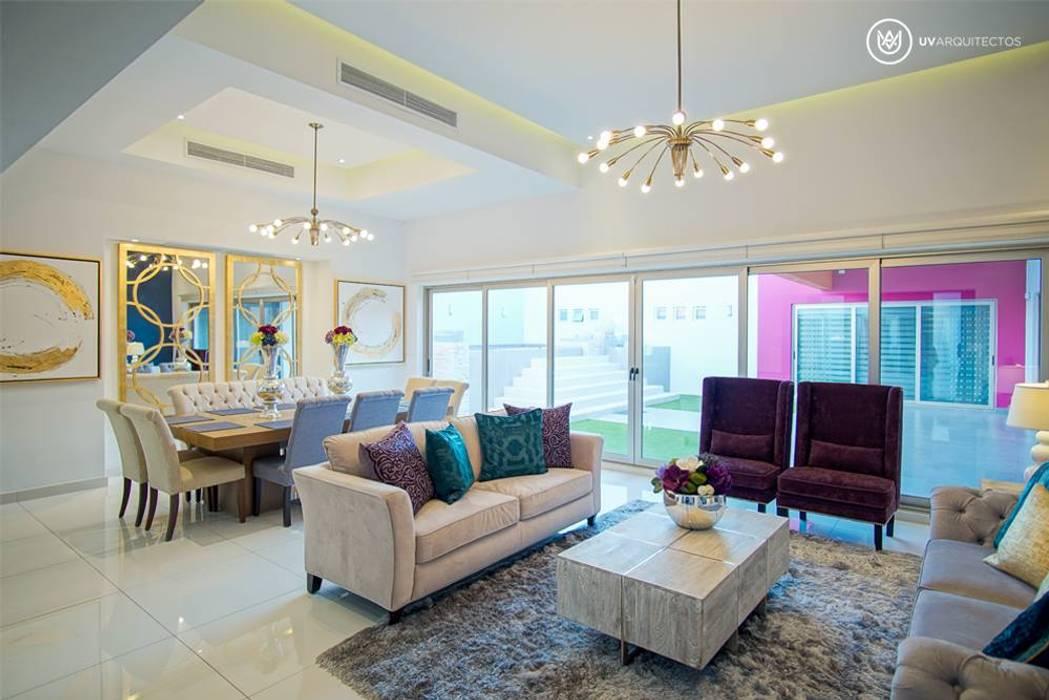Salones de estilo  de UV Arquitectos, Moderno