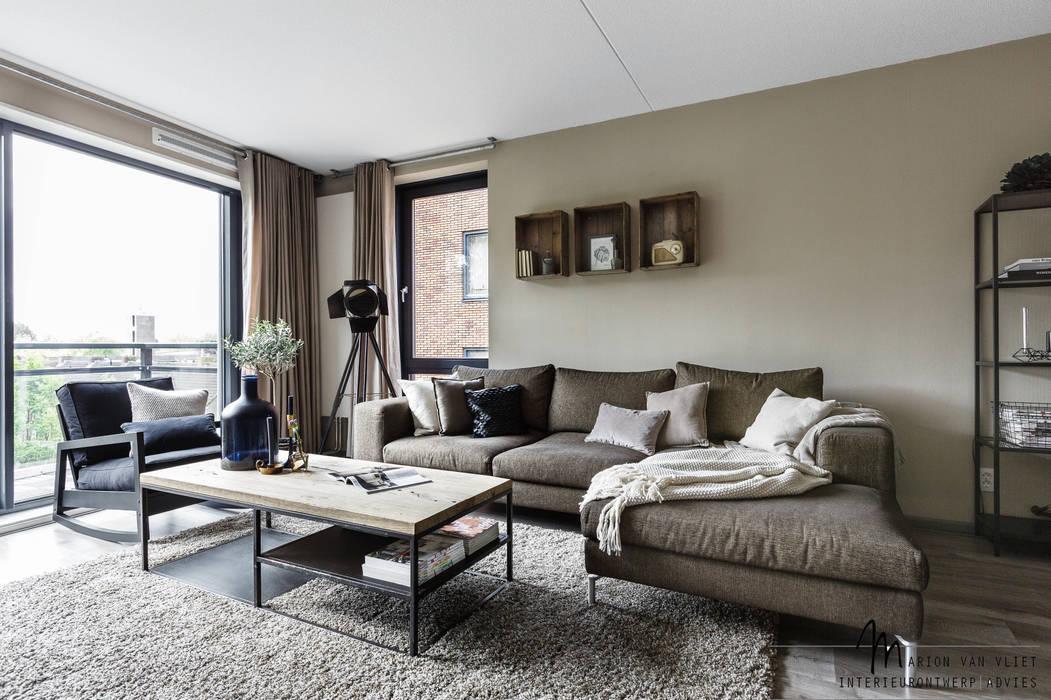 Living room by Marion van Vliet Interieurontwerp, Industrial
