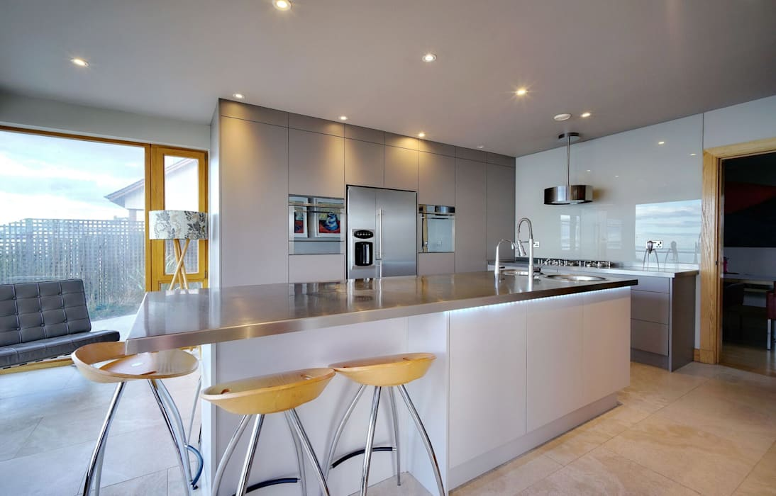 Large Island and Appliance Wall:  Kitchen by ADORNAS KITCHENS