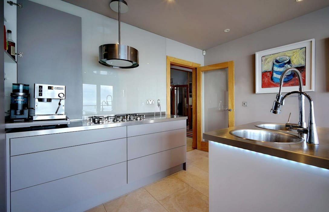 Clever Storage with a pull out coffee machine: modern Kitchen by ADORNAS KITCHENS