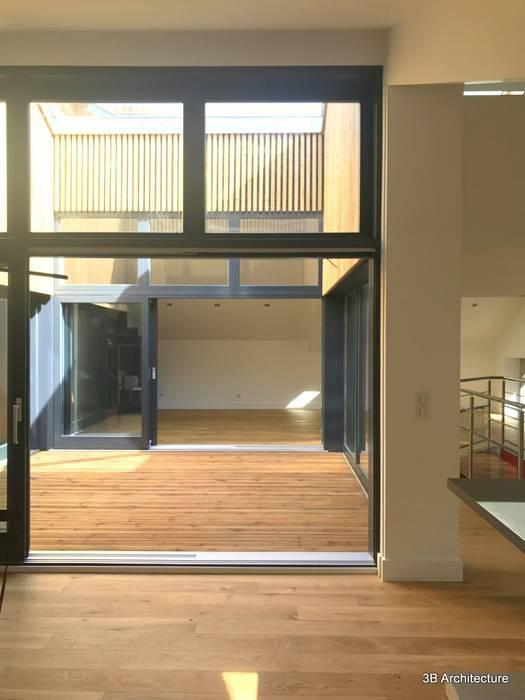 Vue traversante: Terrasse de style  par 3B Architecture