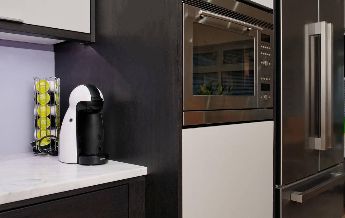 Integrated Modern Appliances: modern Kitchen by ADORNAS KITCHENS