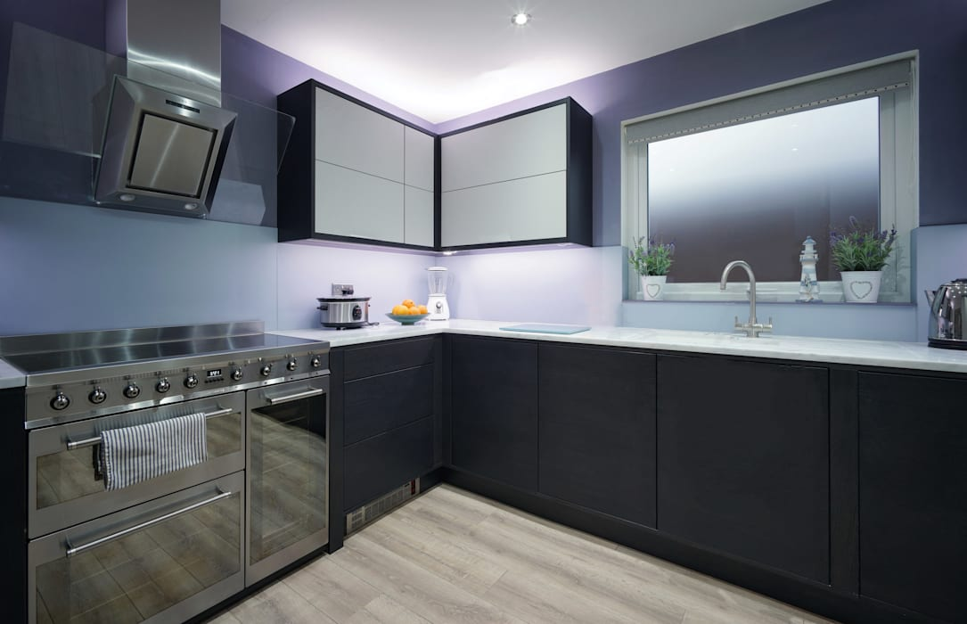 Clever Halo Lighting frames the Two-Tone Bifold Cabinets:  Kitchen by ADORNAS KITCHENS