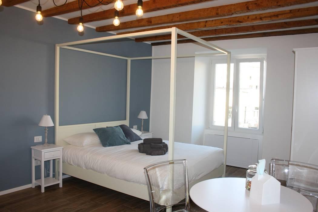 Dormitorios de estilo ecléctico de studio ferlazzo natoli Ecléctico