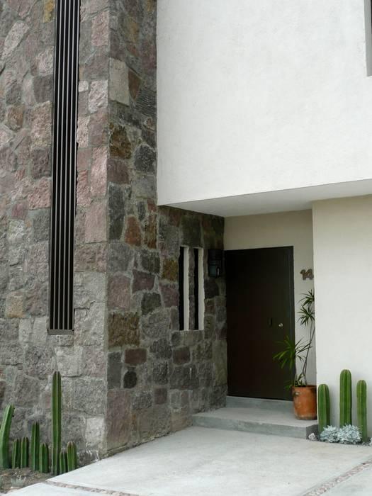 Casa de estilo ecléctico contemporáneo: Casas de estilo ecléctico por Alberto M. Saavedra