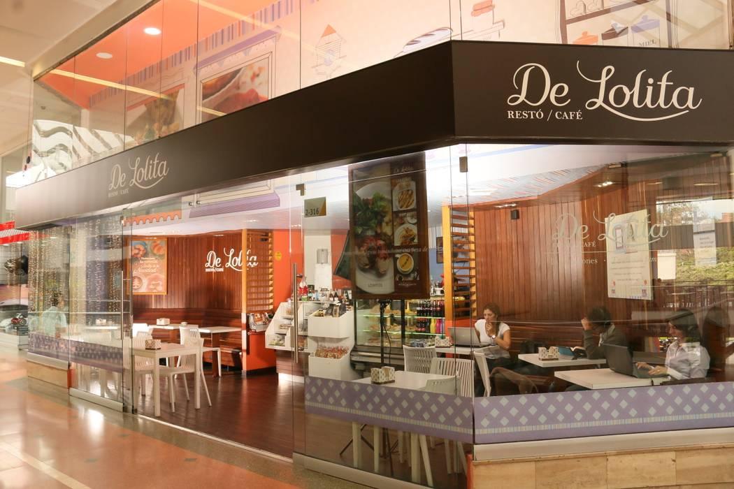 DeLolita Unicentro: Espacios comerciales de estilo  por @tresarquitectos