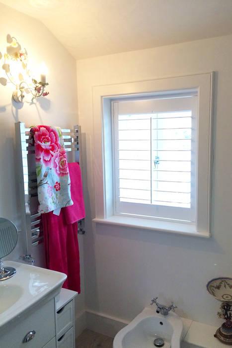 Modern shutters for bathrom windows:  Bathroom by Plantation Shutters Ltd
