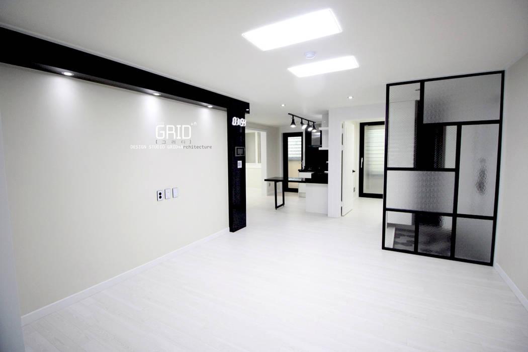 Ruang Keluarga oleh Design Studio Grid+A