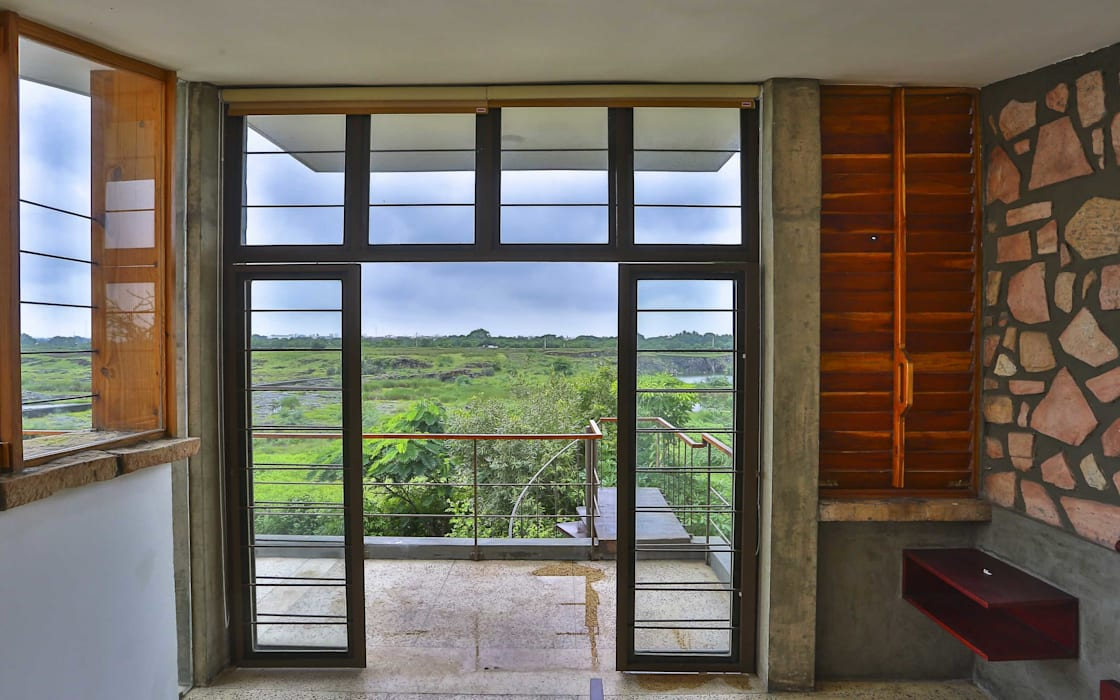 Villa Aaranyak Modern windows & doors by prarthit shah architects Modern