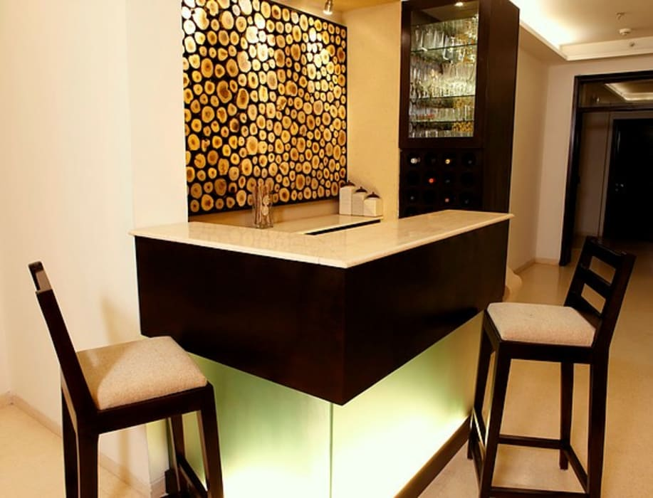 An apartment in Palm springs, Gurgaon Modern wine cellar by stonehenge designs Modern