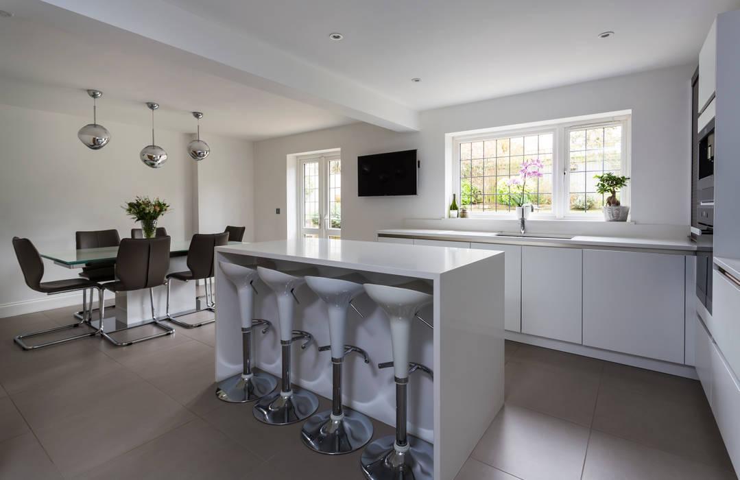White kitchen in Hertfordshire by John Ladbury: modern Kitchen by John Ladbury and Company