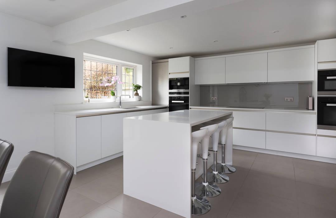 White kitchen in Hertfordshire by John Ladbury and Company:  Kitchen by John Ladbury and Company