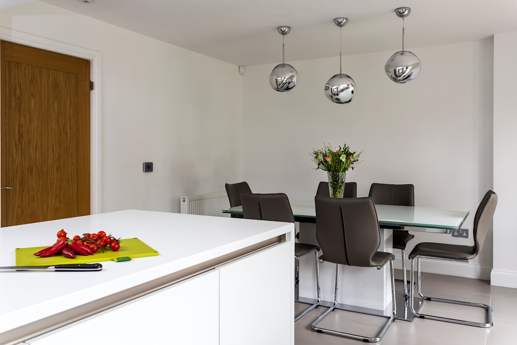 White contemporary kitchen in Hertfordshire by John Ladbury and Company:  Kitchen by John Ladbury and Company