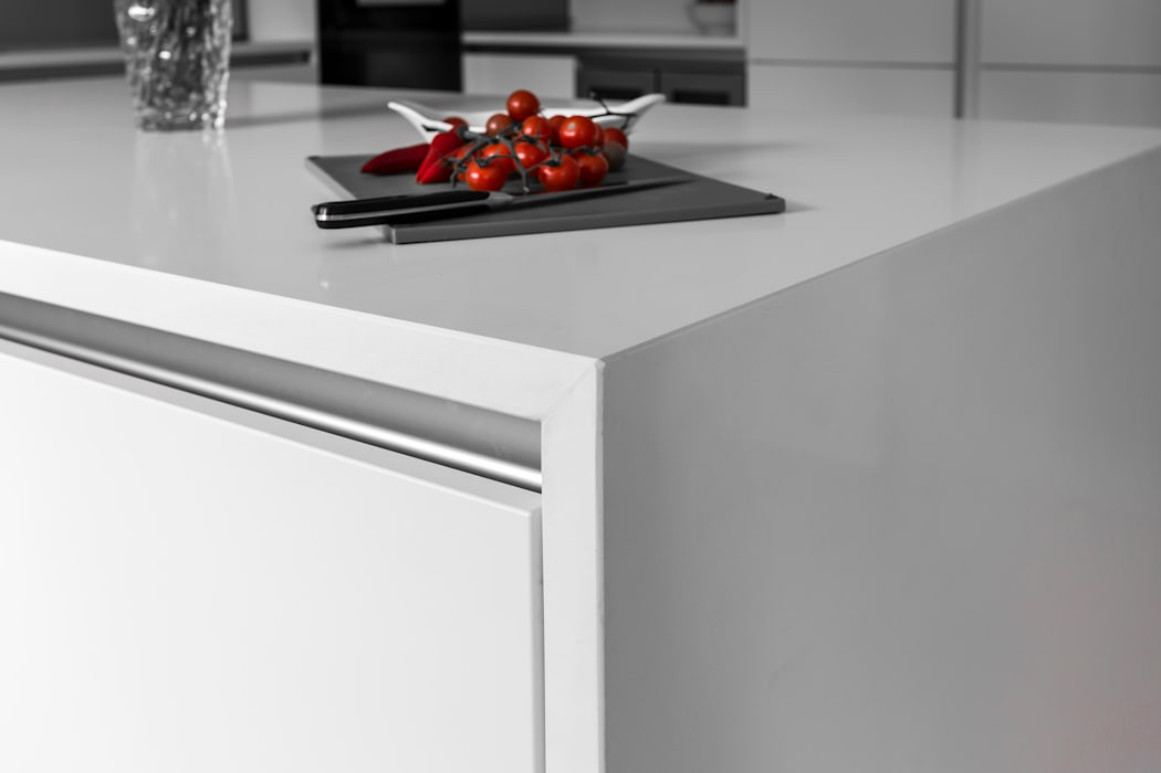 White contemporary kitchen in Hertfordshire by John Ladbury and Company.: modern Kitchen by John Ladbury and Company