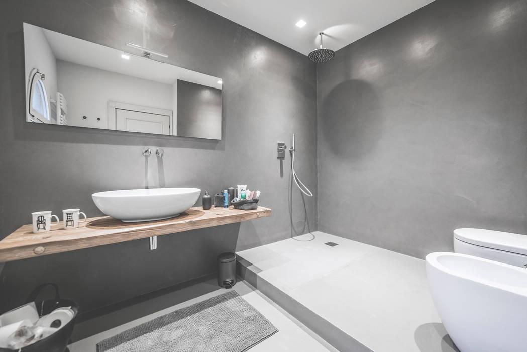 Baños minimalistas de MODO Architettura Minimalista