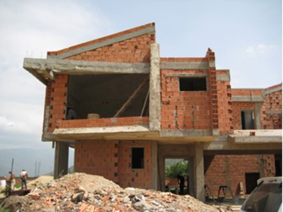 Vista Frontal. Vivienda V12.  Obra Gris.: Casas de estilo  por Eisen Arquitecto