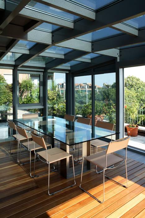 Jardines de invierno modernos de T+T ARCHITETTURA Moderno