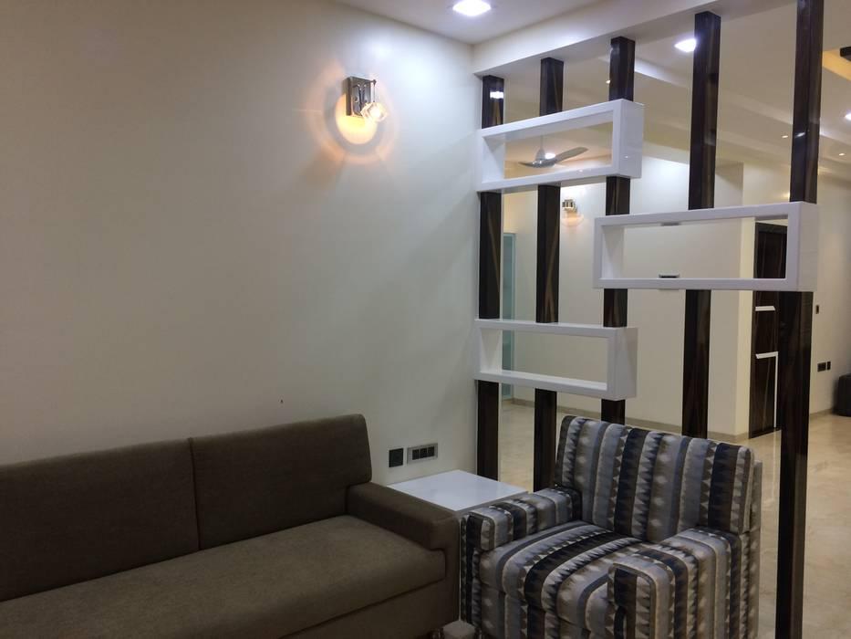 Living Room Partition :  Living room by Nabh Design & Associates