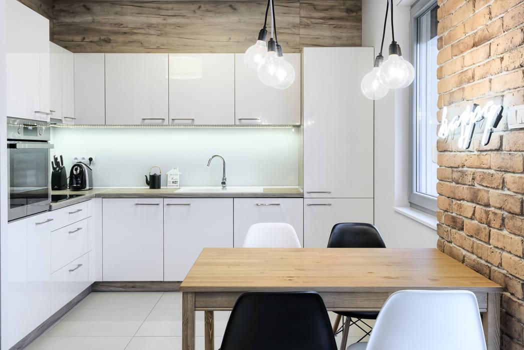 Salle à manger de style  par Partner Design,