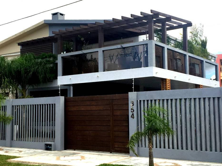 Rustikale Häuser von TM&LH_ arq.arte - Tatiana Moraes e Lucia Helena Rustikal